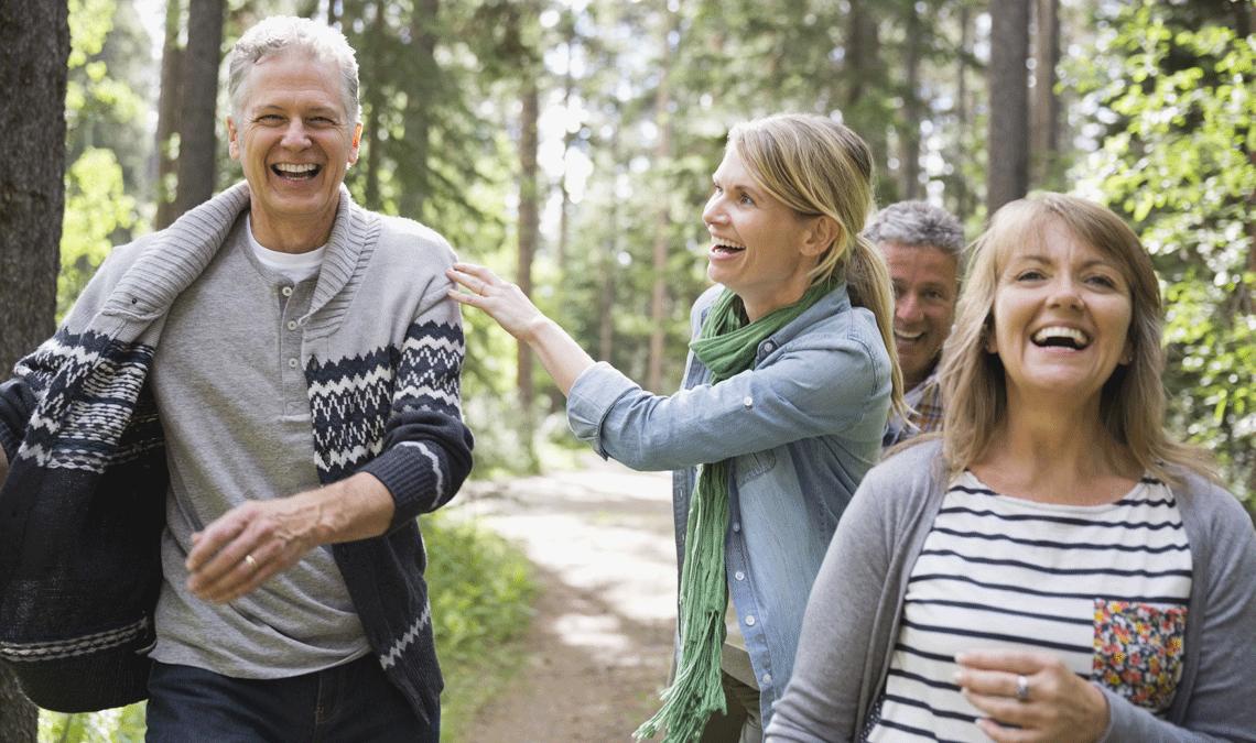 Two couples enjoying a hike