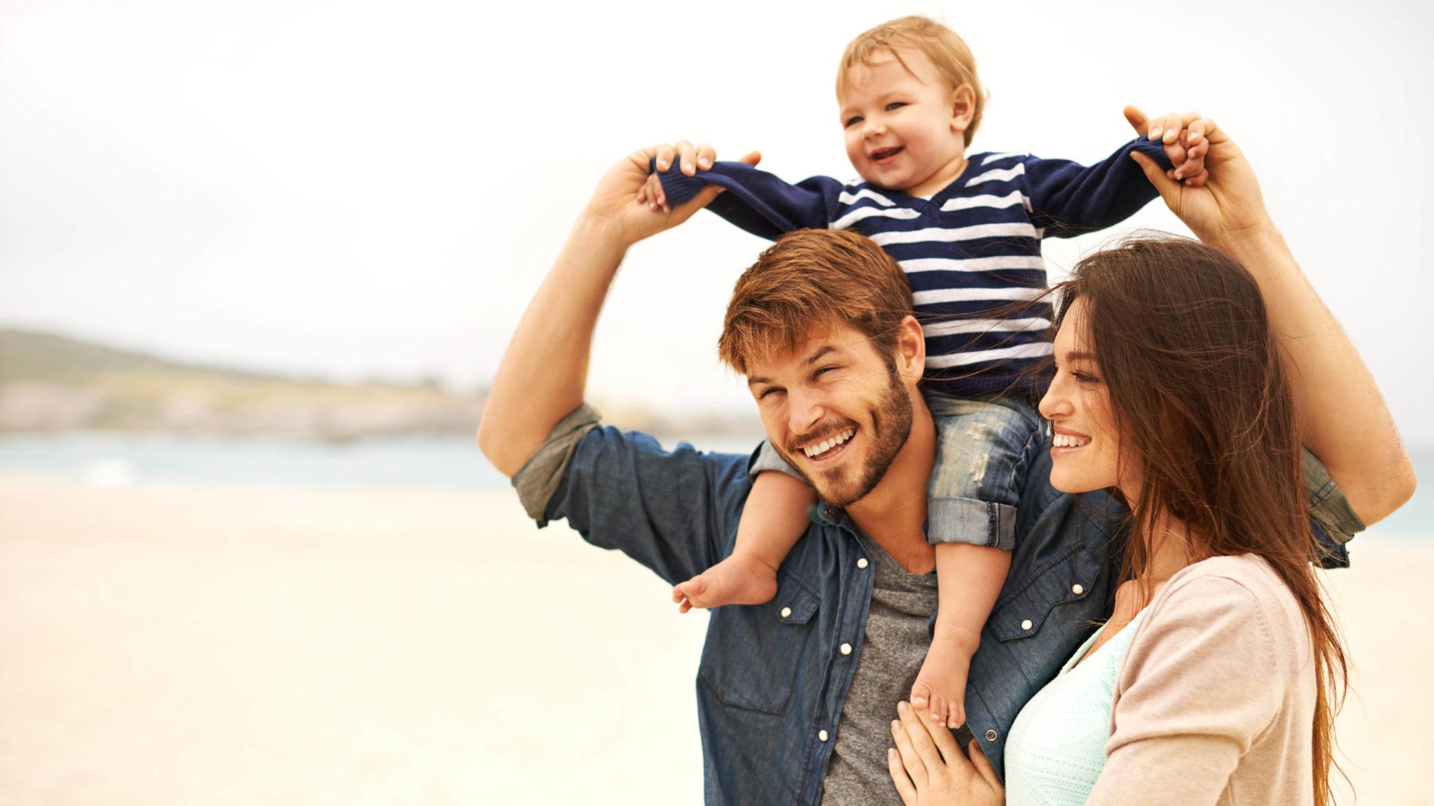 Family of three on the beach